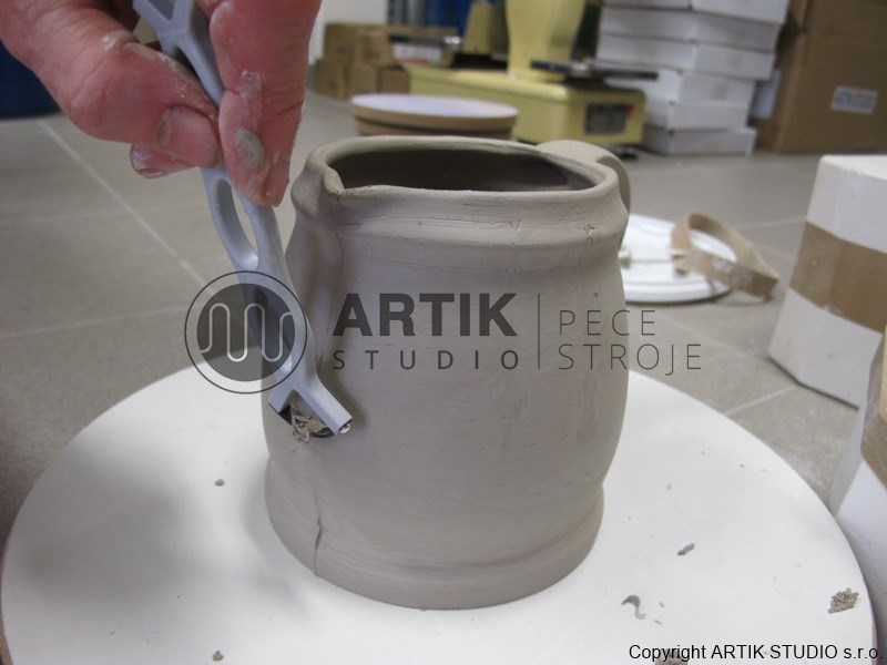 Example of cleaning up of cast from plaster mould